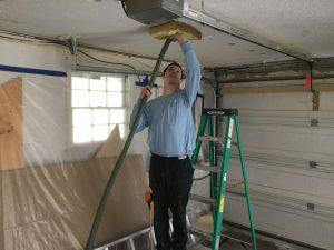 A technician installing insulation